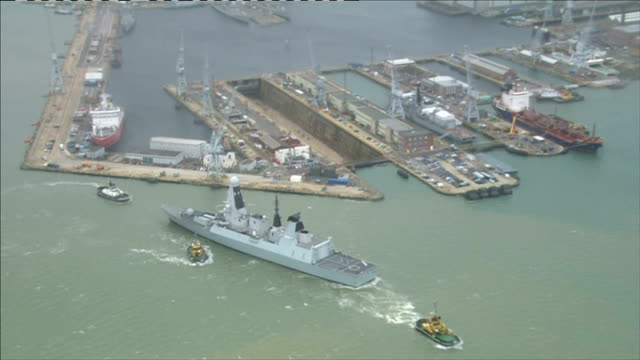 bae systems cut almost 1800 shipyard jobs across the uk england hampshire portsmouth warship along from harbour air view partially built ship in dry... - dry dock stock videos & royalty-free footage