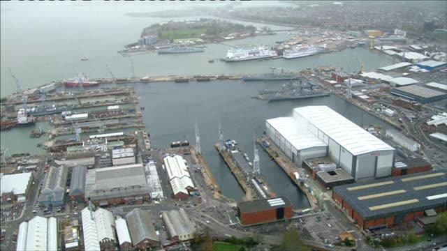 vídeos y material grabado en eventos de stock de systems cut almost 1800 shipyard jobs across the uk; england: hampshire: portsmouth: aerial portsmouth docks and shipyards - hampshire