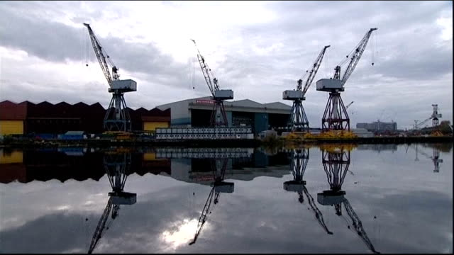 BAE Systems cut almost 1800 shipyard jobs across the UK SCOTLAND Glasgow EXT Wide shot dockyards with cranes Close shot scaffolding and dockyard...