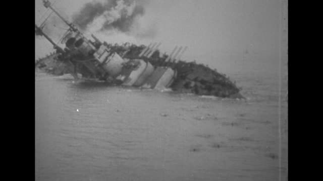 szent istvan battleship in the austrohungarian navy capsizes and sinks after being hit by a torpedo by italy during world war i crewmen swim in water... - warship stock videos & royalty-free footage