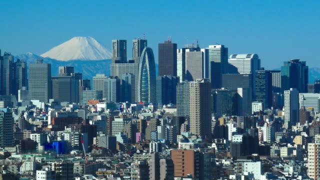 m't fuji and shinjuku buildings fine day - city life点の映像素材/bロール