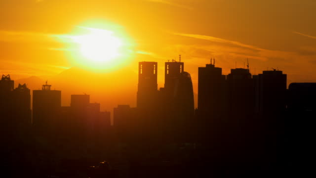 M't Fuji and Shinjuku buildings sunset on the summit