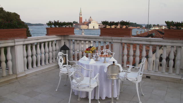 ws ds. table and chairs on balcony / venice, italy - seat stock videos & royalty-free footage