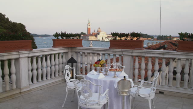 WS DS. Table and chairs on balcony / Venice, Italy