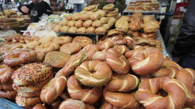 a table displays sesame round bread for sale in jerusalem. - jerusalem stock videos & royalty-free footage