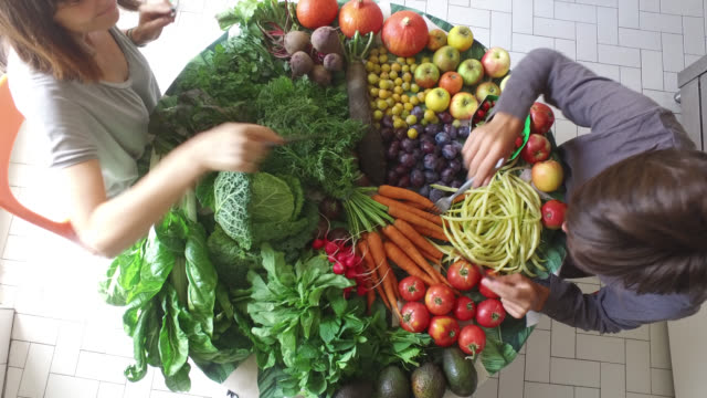 table full of fruits and vegetables - vegetable stock videos & royalty-free footage