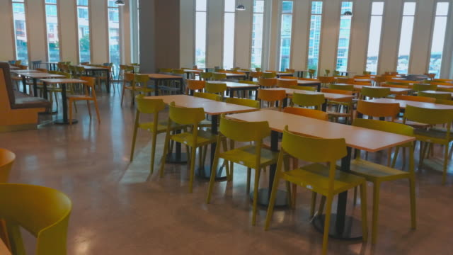 table in office building panning shot by smart phone - canteen stock videos & royalty-free footage