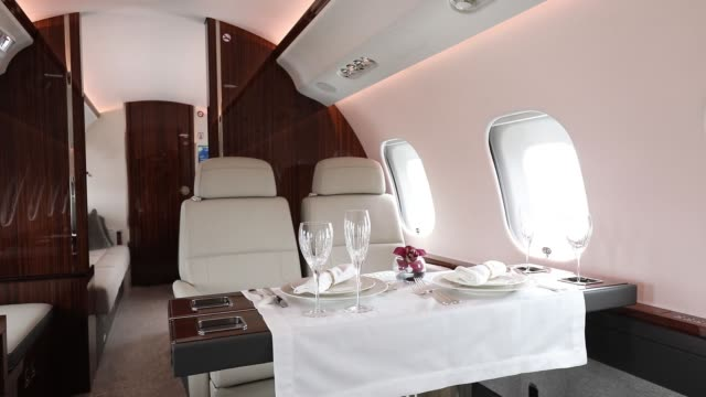A table is set for dining aboard a Bombardier Inc Global 6000 business jet during the Singapore Airshow held at the Changi Exhibition Centre in...