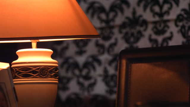cu slo mo table lamp turning on and off / manchester, united kingdom   - ランプ点の映像素材/bロール