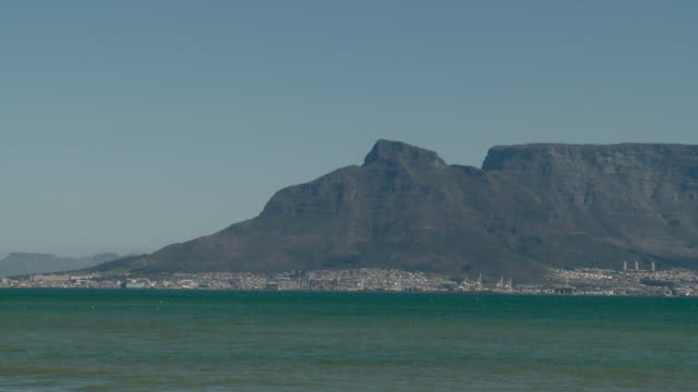 ws pan table mountain and lion's head across sea, cape town, western cape province, south africa - lion's head mountain stock videos and b-roll footage