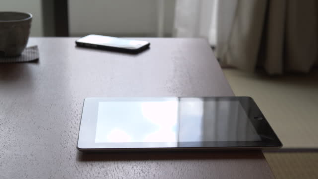 table on digital tablet in room - table stock videos & royalty-free footage