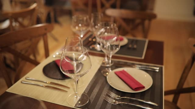 table set for dinner in restaurant - wood plate stock videos & royalty-free footage