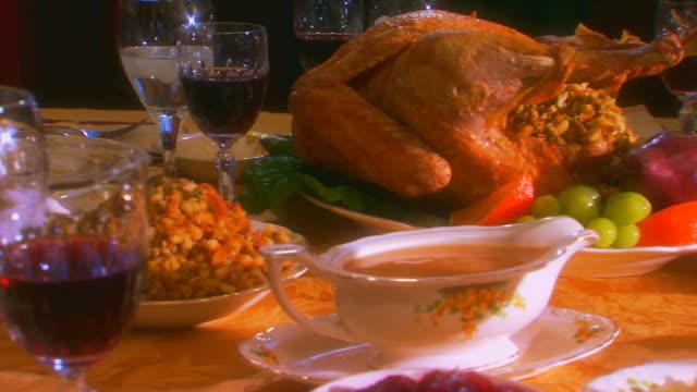 table set for thanksgiving dinner, jib shot, pan right - brühe stock-videos und b-roll-filmmaterial