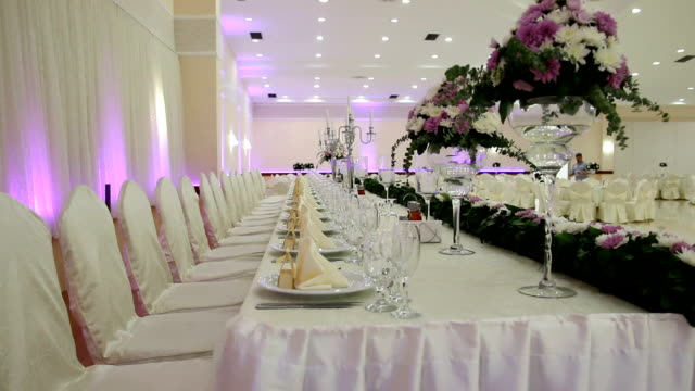 table setting at a luxury wedding reception - banquet hall stock videos & royalty-free footage