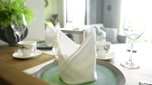 table setting with cutlery, napkin and glass on the table. - bicchiere da vino video stock e b–roll