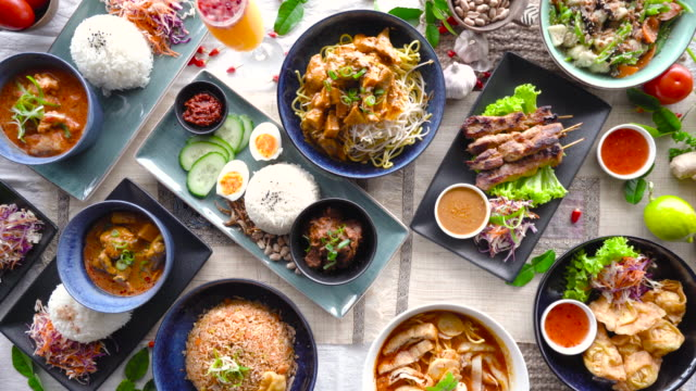 table top view of malaysian food. - flat lay stock videos & royalty-free footage