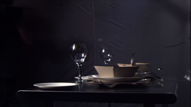 a tablecloth is whisked from under two  table settings. - tischtuch stock-videos und b-roll-filmmaterial