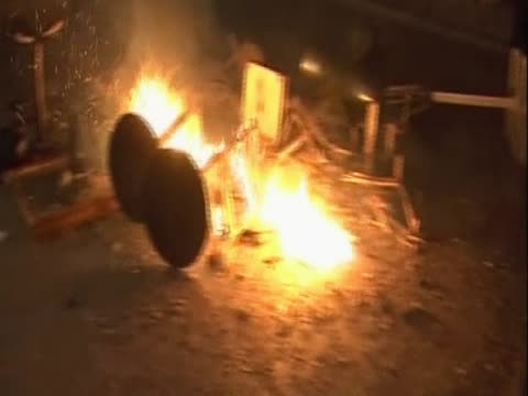 tables and chairs burn in front of a starbucks following the protests in greece against austerity measures - ユーロ圏債務危機点の映像素材/bロール