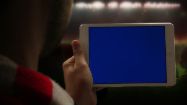 tablet at the game. chromakey screen for your message. - net sports equipment stock videos and b-roll footage