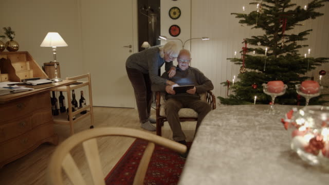 tablet christmas online shopping seniors searching surfing internet - denmark stock videos and b-roll footage
