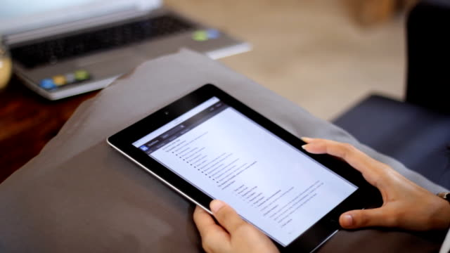tablet close up with hand searching internet browser