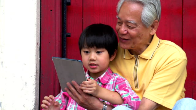 Tablet Grandfather and Grandson