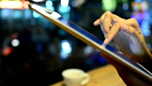 Tablet in coffeeshop at night