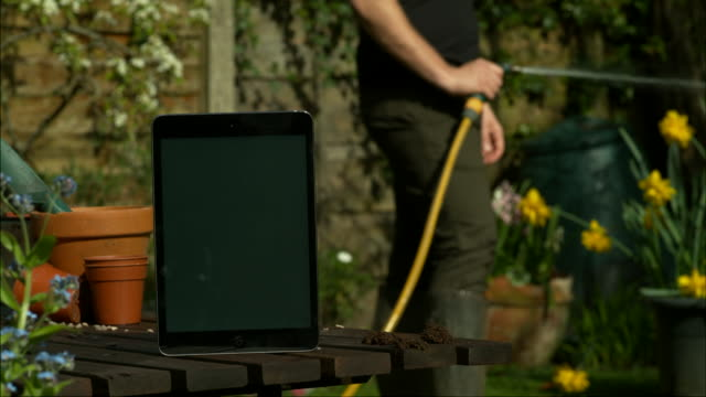 tablet in garden - flowerbed stock videos & royalty-free footage