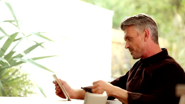 tablet man, relaxing. - electronic banking stock videos & royalty-free footage