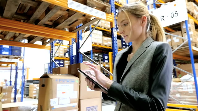 tablet networking in modern warehouse - warehouse stock videos and b-roll footage