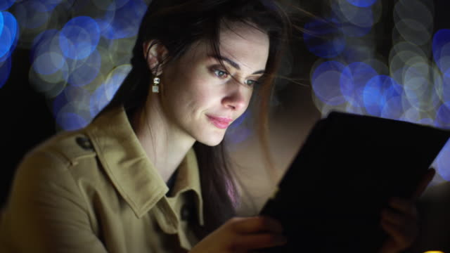 tablet night woman beauty bokeh - multimedia stock videos & royalty-free footage