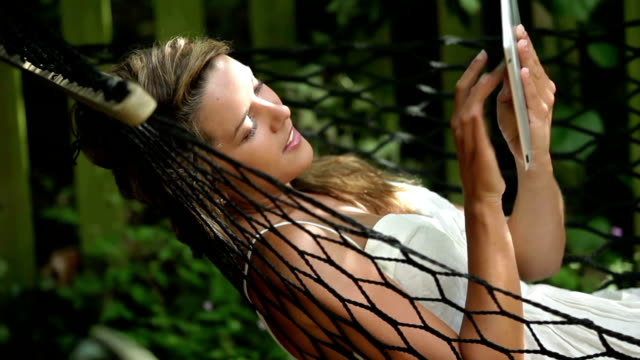tablet pc hammock    cm  li  re - hammock stock videos & royalty-free footage