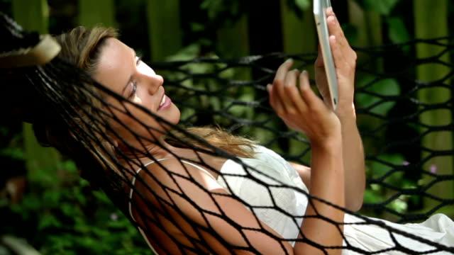 tablet pc hammock   cm li - hammock stock videos & royalty-free footage