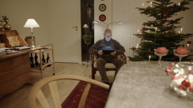 tablet senior christmas online shopping searching surfing male man internet - one man only stock videos & royalty-free footage