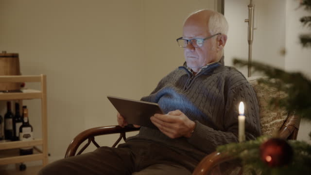 tablet senior christmas online shopping searching surfing man male internet - one man only stock videos & royalty-free footage