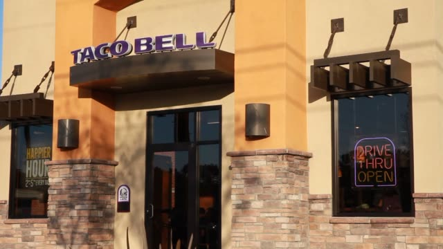 taco bell yum brands locations in torrance calif united states on wednesday jan 29 taco bell drive thru signage shots of a neon light sign in the... - torrance stock videos & royalty-free footage