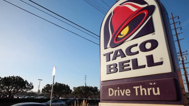 taco bell yum brands locations in torrance calif united states on wednesday jan 29 shots of a taco bell sign on a busy street in torrance california... - torrance stock videos & royalty-free footage
