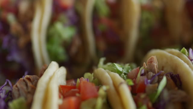 taco served at self service restaurant - tortilla flatbread stock videos & royalty-free footage