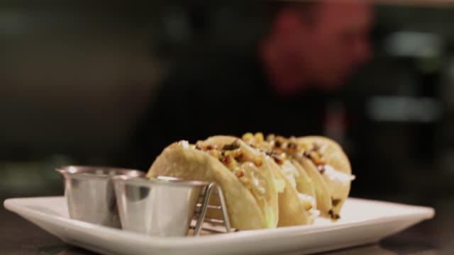 3 tacos with guacamole and corn salsa - tortilla flatbread stock videos & royalty-free footage