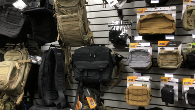 tactical is an irvine californiabased brand of clothing consisting of uniforms and tactical equipment for military law enforcement and public safety... - gun shop点の映像素材/bロール