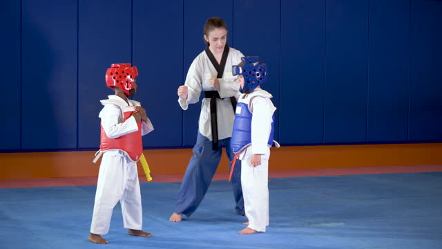 taekwondo teacher with boys in protective gear - contestant stock videos & royalty-free footage