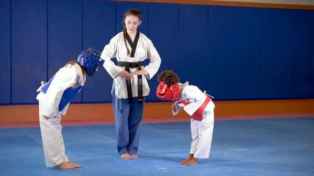 taekwondo teacher with girls in protective gear - 16 17 years stock videos & royalty-free footage