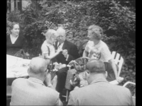 taft family home in ohio / william howard taft on porch with family members / us senator robert taft with his wife martha on left grandchildren... - top hat stock videos & royalty-free footage