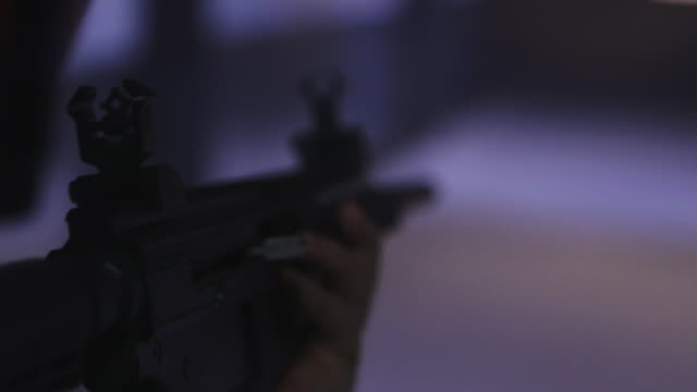 taget shooting at gun range, over the shoulder - shooting range stock videos and b-roll footage