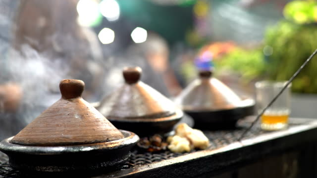tagine stew, marrakech at night - north africa stock videos & royalty-free footage