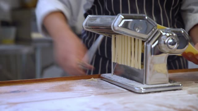 tagliatelle rolled though a pasta maker - rolling stock videos & royalty-free footage