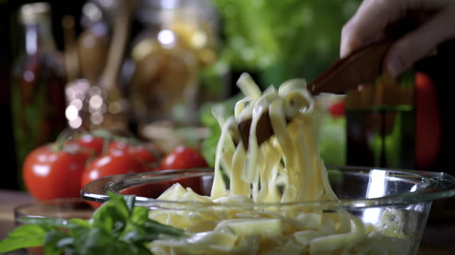 tagliatelle - serving tongs stock videos & royalty-free footage