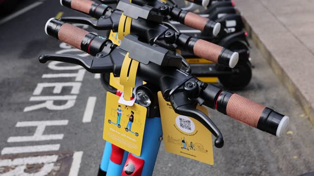 tags with scannable qr codes are displayed on scooters lined up during a photo-call at the launch of an e-scooter pilot program on june 07, 2021 in... - coding stock videos & royalty-free footage