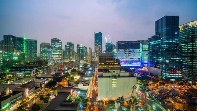taguig timelapse at night bgc high street city skyline view of retail office and - day stock videos & royalty-free footage