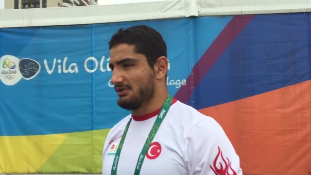 taha akgul who claims turkey's first men's wrestling olympic gold speaks to the press during an exclusive interview in rio de janerio on august 21... - olympic medal stock videos & royalty-free footage